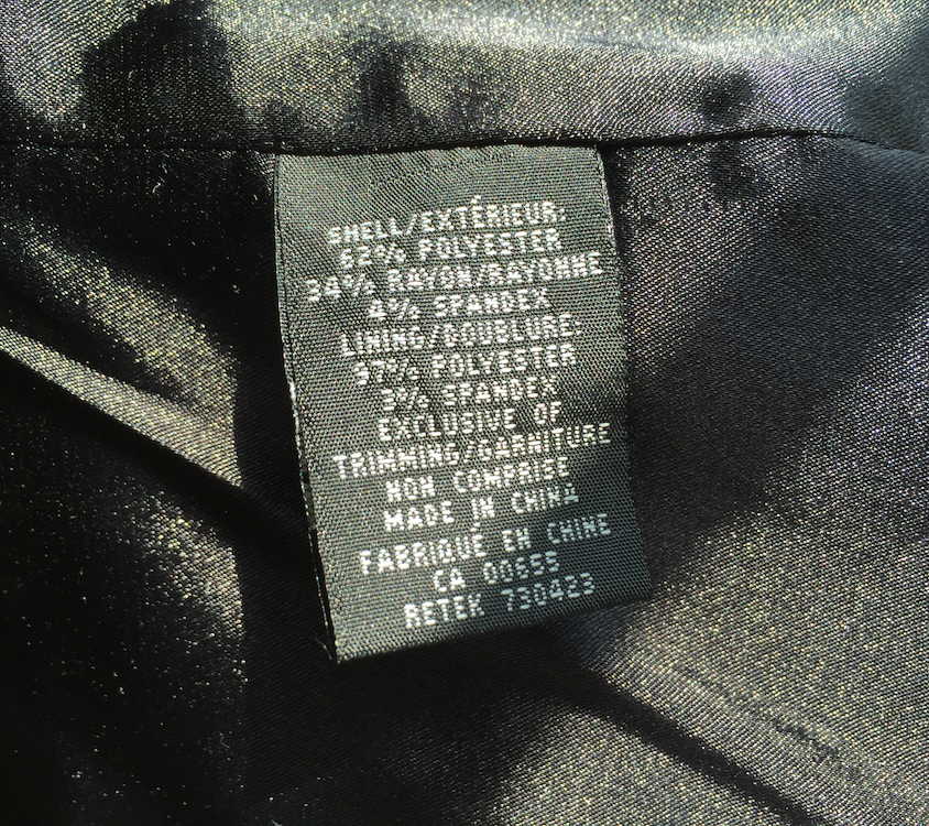 Clothing tag stating polyester content of garment