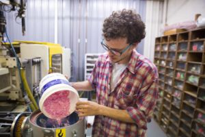 Dresden engineer Recycling Skim Milk bottle lids into eyewear frames.